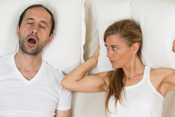 Female partner frustrated with male for snoring